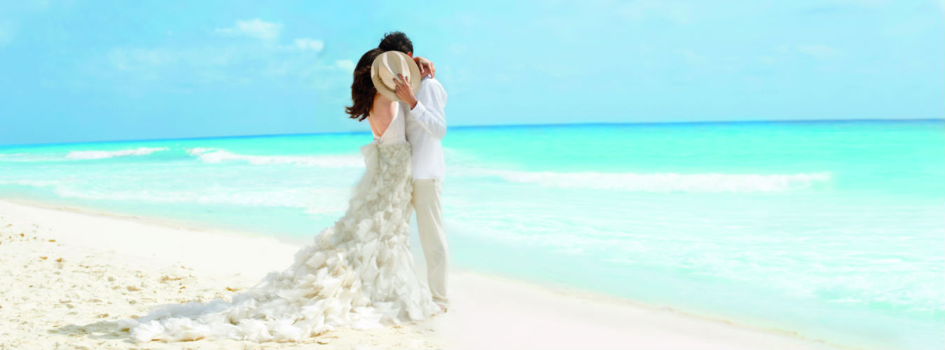 Bride and Groom on beach - Couples Page